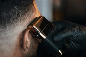 barber-shaves-side-of-persons-head